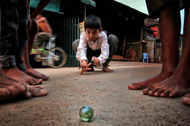 kid playing marble