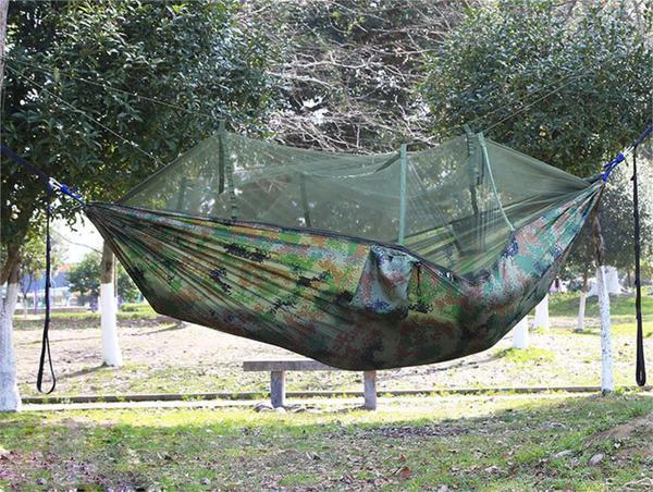 enjoy swinging without being seen in this camouflage mosquito net covered hammoc