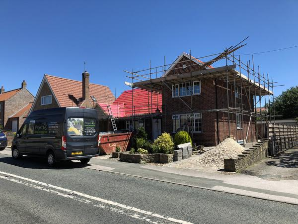 project 4 s brick laying team expanded to take on more home extension projects