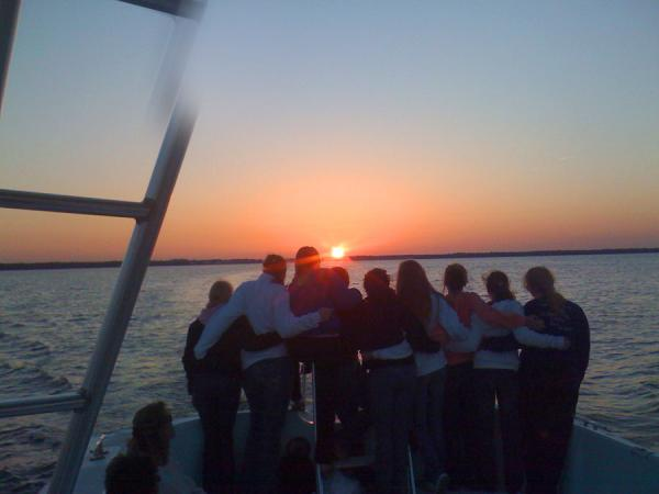 cruise under the sunset with dolphin cruises aboard the cold mil fleet