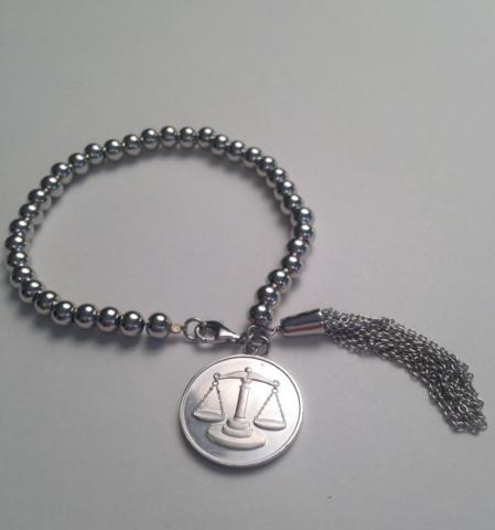supply justice introduces a scales of justice sterling bracelet for gift giving